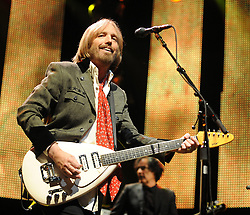 TOM PETTY (Oct. 20, 1950 - Oct. 02, 2017) is an American musician, singer, songwriter, multi instrumentalist and record producer. He is best known as the lead singer of Tom Petty and the Heartbreakers, but is also known as a member and co-founder of the late 1980s supergroup the Traveling Wilburys. Petty has sold more than 80 million records worldwide, making him one of the best-selling music artists of all time.He was inducted into the Rock and Roll Hall of Fame in 2002. PICTURED: September 18, 2010 - Raleigh, North Carolina, U.S. - TOM PETTY and the Heartbreakers perform at the Time Warner Cable Music Pavilion. (Credit Image: © Jason Moore/ZUMApress.com)