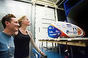 De rijders Christien Veelenturf en Rik Houwers staan in de wind. In Delft test het Human Power Team Delft en Amsterdam (HPT) hun nieuwe fiets, de VeloX4, in de windtunnel. In september wil het HPT, dat bestaat uit studenten van de TU Delft en de VU Amsterdam, een poging doen het wereldrecord snelfietsen te verbreken, dat nu op 133,8 km/h staat tijdens de World Human Powered Speed Challenge.<br /> <br /> Riders Rik Houwers and Christien Veelenturf standing in the wind. The Human Power Team Delft and Amsterdam (HPT) test their new bike, the VeloX4, in the wind tunnel in Delft. With the special recumbent bike the HPT, consisting of students of the TU Delft and the VU Amsterdam, also wants to set a new world record cycling in September at the World Human Powered Speed Challenge. The current speed record is 133,8 km/h.