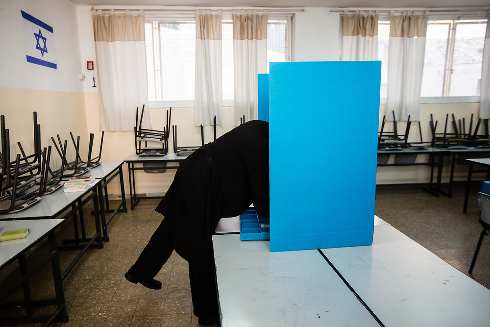 An ultra-Orthodox Jewish man casts his vote at a polling station in Jerusalem, Israel, on March 17, 2015, as Israelis vote in early parliament elections.