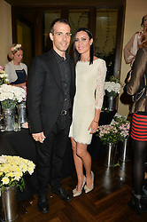 WILL STOPPARD and LINZI STOPPARD at a party to celebrate the 15th anniversary of Myla held at the House of Myla, 8-9 Stratton Street, London on 21st October 2014.