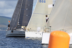 Peelport Clydeport Largs Regatta Week 2013 <br /> <br /> FRA37296, Salamander XXI, First 35, John Corson, FYC, crosses the Class 1 line on port<br /> <br /> Largs Sailing Club, Largs Yacht Haven, Scottish Sailing Institute