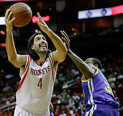 April 21, 2012; Houston, TX, USA; Houston Rockets power forward Luis Scola (4) drives past Golden State Warriors center Mickell Gladness (32) during the first quarter at the Toyota Center. Mandatory Credit: Thomas Campbell-US PRESSWIRE