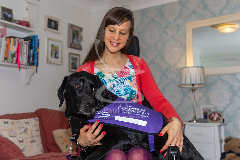 Illnesses in her teens has left Sally Whitney from Brighton, who suffers from seizures, in a wheelchair and dependent on her assistance dog Ethan. The highly trained black Labrador can get help when she needs it , can fetch and put things away for her, and can even pay for shopping with contactless payment cards. Brighton, March 02 2019.