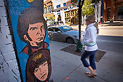 A person passes trendy wall art in the hip neighborhood of Wicker Park in Chicago, IL, USA.