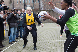 © Licensed to London News Pictures. 09/12/2014. London, UK. The Mayor of London, Boris Johnson takes part in a netball match with a team from Ealing, Hammersmith and Fulham College in West London. Photo credit : Vickie Flores/LNP