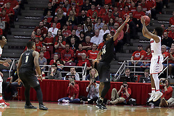 """20 March 2017:  Daouda """"David"""" Ndiaye (4) shoots 3 from the corner with Nick Banyard defending during a College NIT (National Invitational Tournament) 2nd round mens basketball game between the UCF (University of Central Florida) Knights and Illinois State Redbirds in  Redbird Arena, Normal IL"""