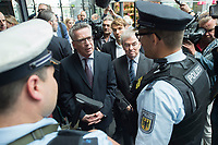 """23 JUN 2016, BERLIN/GERMANY:<br /> Thomas de Maiziere (L), CDU, Bundesinnenminister, und Klaus Dauderstaedt (R), Vorsitzender Deutscher Beamtenbund, dbb, im Gespraech mit BEamten der Bundespolizei, waehrend der Vorstellung einer Aktion gegen Gewalt gegen Beschäftigte im öffentlichen Dienst """"Für Sie - für mich - Respekt"""", Hauptbahnhof<br /> IMAGE: 20170623-01-005<br /> KEYWORDS: Thomas de Maizière, Klaus Dauderstädt"""