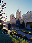 San Felipe de Neri Church, dating to 1793 with the Gothic twin sprires added between 1868 and 1890, Old Town North Plaza, Albuquerque, New Mexico.