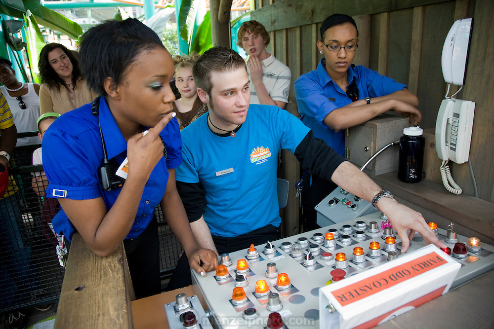 Tiffany Whitehead, a student and part-time ride supervisor at the Mall of America amusement park, speaks to a colleague who controls a ride console which has malfunctioned at the mall in Bloomington, Minnesota. (Tiffany Whitehead is featured in the book What I Eat: Around the World in 80 Diets.) MODEL RELEASED.