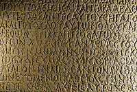 The Ezana inscription (on the Ezana Stone) was established by King Evan of Aksum in the 4th century AD. The inscription narrates the war memory of King Evan and how he defeated his enemies in the battle field. The inscription was written in three ancient languages: Greek, Sabean and Ge'ez. (This side is in Greek) Axum (Aksum), Ethiopia.