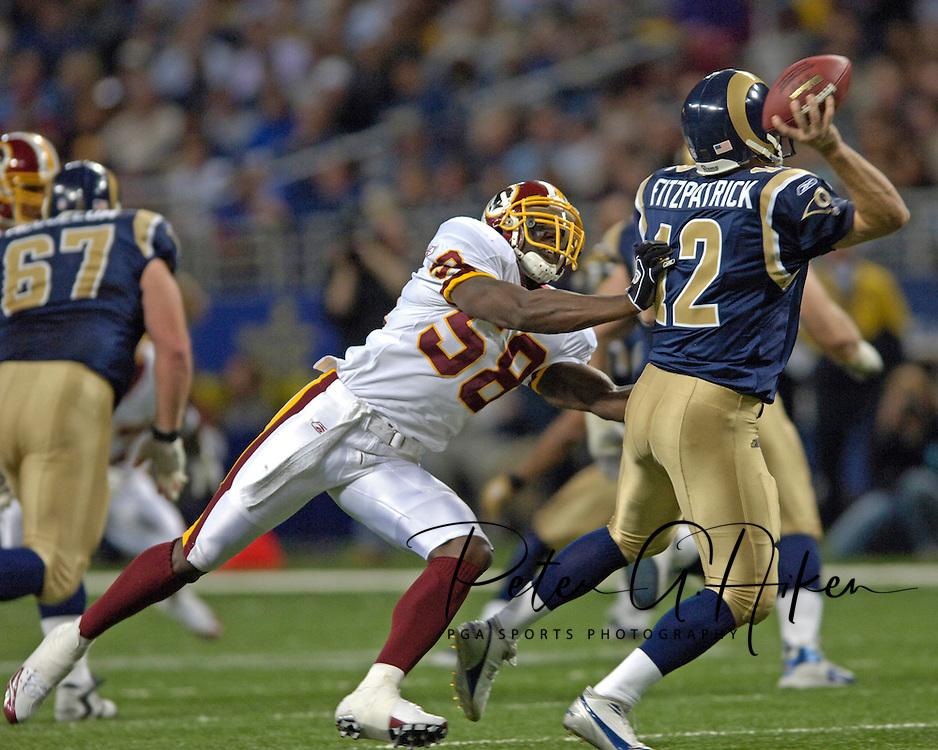 Washington Redskins linebacker Chris Clemons (L) pressures St. Louis Rams quarterback Ryan Fitzpatrick (R) in the second quarter, during the Redskins 24-9 win at the Edward Jones Dome in St. Louis, Missouri, December 4, 2005.