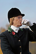 Cambridgeshire, England, 05/11/2003..The Fitzwilliam Hunt on their first meet of what may be the last legal hunting season in the UK, as Parliament moves to ban hunting with dogs..Hunters and followers enjoy a 'stirrup cup': the traditional drink before the start of the hunt.