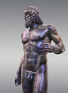 The Riace bronze Greek statue A cast about 460 BC. Museo Nazionale della Magna Grecia,  Reggio Calabria, Italy. . .<br /> <br /> If you prefer to buy from our ALAMY STOCK LIBRARY page at https://www.alamy.com/portfolio/paul-williams-funkystock/greco-roman-sculptures.html . Type -    Riace     - into LOWER SEARCH WITHIN GALLERY box - Refine search by adding a background colour,  etc.<br /> <br /> Visit our ROMAN WORLD PHOTO COLLECTIONS for more photos to download or buy as wall art prints https://funkystock.photoshelter.com/gallery-collection/The-Romans-Art-Artefacts-Antiquities-Historic-Sites-Pictures-Images/C0000r2uLJJo9_s0