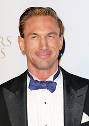 © Licensed to London News Pictures. 07/11/2013. Dr Christian Jessen at the Battersea Dogs & Cats Home Collars & Coats Gala Ball at Battersea Evolution, London UK. Photo credit: by Richard Goldschmidt/LNP