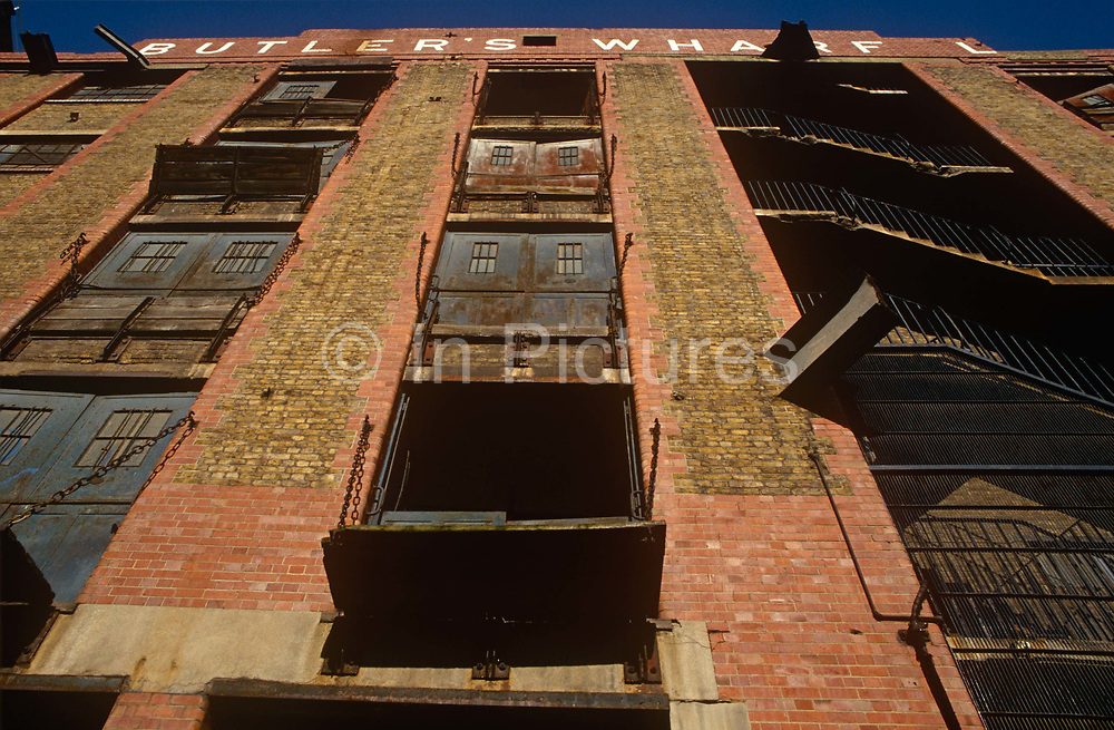 The still-semi derelect Butlers Wharf, 19th century Thameside warehouses, before its renovation and redevelopment later that decade, on 11th September 1993, on the River Thames, London, England.