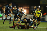 Blaine Scully of the Cardiff Blues is tackled by Aaron Shingler of the Scarlets. Guinness Pro12 rugby match, Cardiff Blues v Scarlets at the BT Cardiff Arms Park in Cardiff, South Wales on Friday 28th October 2016.<br /> pic by Andrew Orchard, Andrew Orchard sports photography.