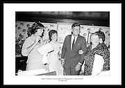 John F. Kennedy visits his relatives at his ancestral homestead in Dunganstown, County Wexford. Pictured here with his second-cousin Mary Ryan and her daughter Josephine Ryan.<br />
