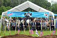 A Korean flag rests among American flags and shovels  before the groundbreaking ceremony for the construction of the Korean War Memorial, America-Korean Alliance Peace Park Tuesday, August 8, 2017 at Memorial Grove Park in North Wales, Pennsylvania. (WILLIAM THOMAS CAIN / For The Philadelphia Inquirer)