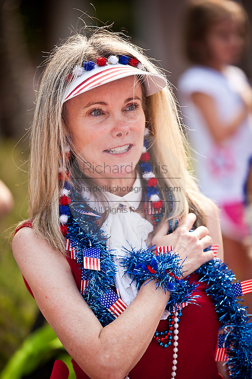 A woman dressed in patriotic costume stands for the pledge in the I'On Community 4th of July parade.