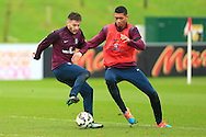 Adam Lallana and Chris Smalling of England - England Training & Press Conference - UEFA Euro 2016 Qualifying - St George's Park - Burton-upon-Trent - 11/11/2014 Pic Philip Oldham/Sportimage