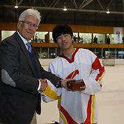 Cheng Zhang, China, receives the Best Forward award for the tournament from Kai Hietariinta, IIHF Tournament Chairman at the conclusion of the 2012 IIHF Ice Hockey World Championships Division 3 held at Dunedin Ice Stadium. Dunedin, Otago, New Zealand. 22nd January 2012. Photo Tim Clayton