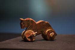 British Museum Ancient Lives press launch. A toy horse on wheels after 30 BC, British Museum, London, United Kingdom. Wednesday, 9th April 2014. Picture by Daniel Leal-Olivas / i-Images