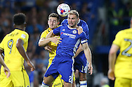 Branislav Ivanovic of Chelsea heads the ball over Tom Lockyer of Bristol Rovers. EFL Cup 2nd round match, Chelsea v Bristol Rovers at Stamford Bridge in London on Tuesday 23rd August 2016.<br /> pic by John Patrick Fletcher, Andrew Orchard sports photography.