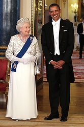 Queen Elizabeth II and US President Barack Obama pose in the Music Room of Buckingham Palace ahead of a State Banquet, as part of the Presidents three-day state visit to the UK.