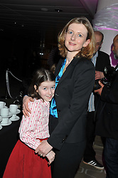 FRANCES OSBORNE and her daughter LIBERTY at a private view of photographs by Joanna Vestey entitled 'Dreams For My Daughter' in aid of The White Ribbon Alliance, held at The Royal Festival Hall, South Bank, London on 8th March 2012.