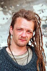 Portrait of homeless man with dreadlocks,