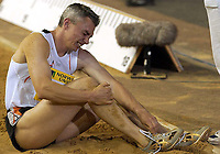 Photograph: Scott Heavey<br />IAAf Super Grand Prix. Norwich Union London Athletics meeting from Crystal Palace. 08/08/2003.<br />Jonathan Edwards holds his ankle in agony.