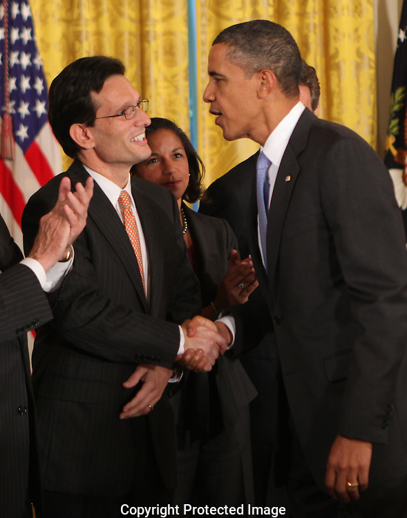 President Barack Obama shakes hands with Representative Eric Cantor R VA at the signing of the Iran Sanctions Act  in the East Room of the White House on July 1, 2010,  Photograph by Dennis Brack