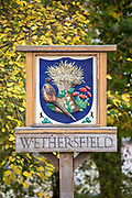 Old traditional village sign in typical quaint Wethersfield village in Essex, England, UK