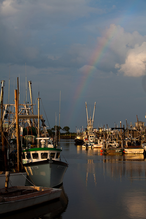 Rainbow over the commercial fishing fleet at Belford Harbor in Belford New Jersey.