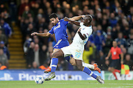 Danilo of FC Porto challenges Diego Costa of Chelsea. UEFA Champions league group G match, Chelsea v Porto at Stamford Bridge in London on Wednesday 9th December 2015.<br /> pic by John Patrick Fletcher, Andrew Orchard sports photography.