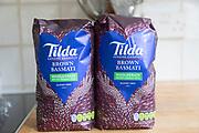 Two packets Tilda brown basmati wholegrain rice gluten free, England, UK