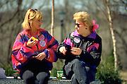 Women age 40 resting and eating orange on MS walk a thon.  St Paul  Minnesota USA