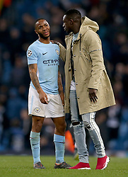 Manchester City's Raheem Sterling (left) appears dejected after the final whistle during the UEFA Champions League, Quarter Final at the Etihad Stadium, Manchester.