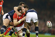 Alan Wyn Jones of Wales © is stopped by Scotland's John Hardie (l) and Finn Russell ®. . RBS Six nations championship 2016, Wales v Scotland at the Principality Stadium in Cardiff, South Wales on Saturday 13th February 2016. <br /> pic by  Andrew Orchard, Andrew Orchard sports photography.