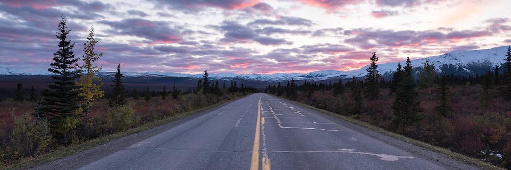 The park road heading towards the mountains at sunset, Denali National Park, Alaska