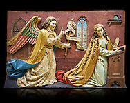 Painted relief panel of the Annonciation of the Virgin, made at the start of the 16th century possibly in the Tyrol, Austria.  Inv 2352 The Louvre Museum, Paris. .<br /> <br /> If you prefer you can also buy from our ALAMY PHOTO LIBRARY  Collection visit : https://www.alamy.com/portfolio/paul-williams-funkystock . Type -    Louvre Madonna     - into the LOWER SEARCH WITHIN GALLERY box. Refine search by adding background colour, place, museum etc<br /> <br /> Visit our MEDIEVAL ART PHOTO COLLECTIONS for more   photos  to download or buy as prints https://funkystock.photoshelter.com/gallery-collection/Medieval-Middle-Ages-Art-Artefacts-Antiquities-Pictures-Images-of/C0000YpKXiAHnG2k .<br /> <br /> If you prefer you can also buy from our ALAMY PHOTO LIBRARY  Collection visit : https://www.alamy.com/portfolio/paul-williams-funkystock/gothic-art-antiquities.html  Type -   louvre     - into the LOWER SEARCH WITHIN GALLERY box. Refine search by adding background colour, place, museum etc<br /> <br /> Visit our MEDIEVAL ART PHOTO COLLECTIONS for more   photos  to download or buy as prints https://funkystock.photoshelter.com/gallery-collection/Medieval-Gothic-Art-Antiquities-Historic-Sites-Pictures-Images-of/C0000gZ8POl_DCqE