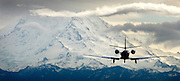 A small private jet has a landing with a spectacular view of Mt. Rainier at Boeing Field. (Ken Lambert / The Seattle Times)