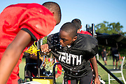 Kids from Deion Sanders youth sports organization, Truth, take a water break at the Prime Prep Academy campus in Dallas, Texas on August 6, 2014. (Cooper Neill for The New York Times)