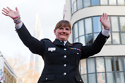 © Licensed to London News Pictures. 23/12/2019. London, UK. London Fire Commissioner (LFC), Dany Cotton waves after making a speech from a vintage fire engine after being greeted by members and family of the Fire Brigade on her final day in office. Hundreds of firefighters lined Union Street in London today to provide a Guard of Honour on the final day in office for London Fire Commissioner, Danny Cotton. Photo credit: Vickie Flores/LNP