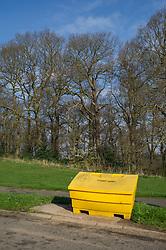 Yellow grit bin ready for winter