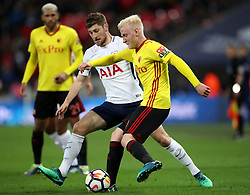 Watford's Will Hughes (right) and Tottenham Hotspur's Erik Lamela battle for the ball during the Premier League match at Wembley Stadium. London.