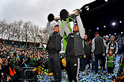 Seattle Sounders midfielder Kim Kee-Hee, left, with teammate forward Handwalla Bwana hold up the MLS Cup trophy during the MLS Cup Champions Parade & Rally on November 12, 2019 in Seattle, Washington, to celebrate the Sounders' win over Toronto FC to win the MLS Cup soccer match in Seattle. (Alika Jenner/Image of Sport)