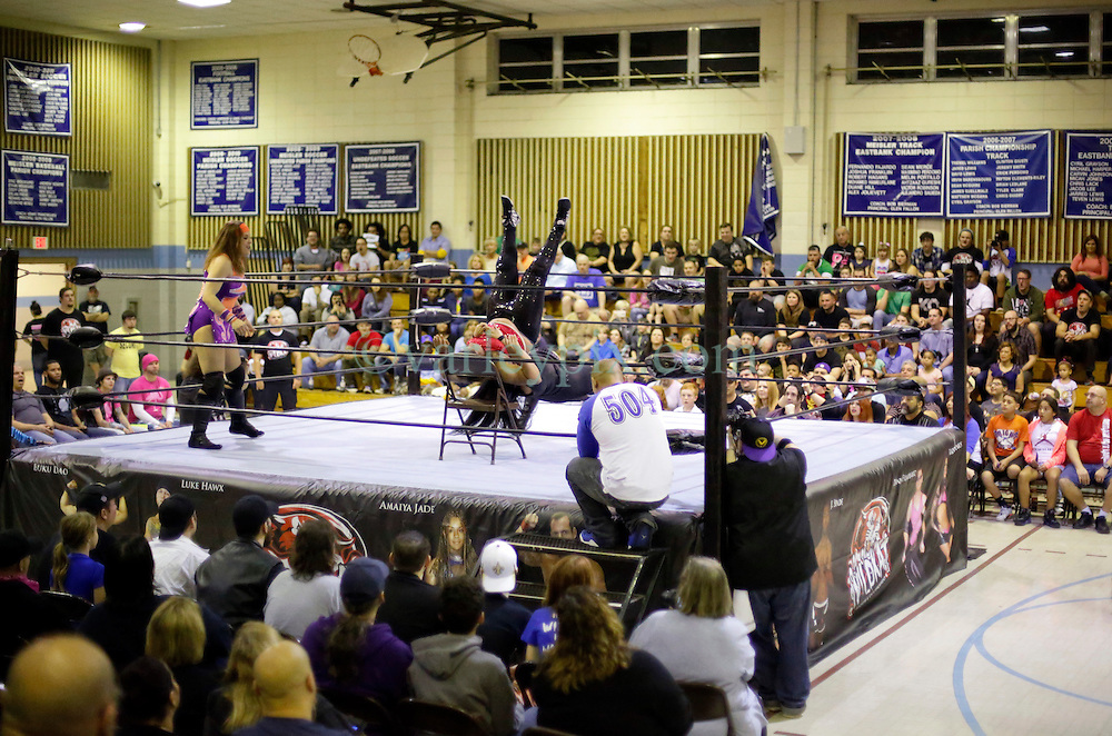 12 March 2016. Metairie, Louisiana.<br /> Wrestling action from Wildkat Sports and Entertainment's 'March into Mayhem' at the Meisler Middle School.<br /> Ruby Raze and Kennadi Brink defeat Renee Michelle. Amaiya Jade is taken away with concussion.<br /> Photo©; Charlie Varley/varleypix.com