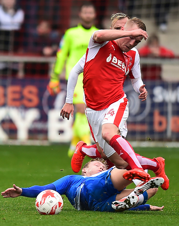 Fleetwood Town's Kyle Dempsey hurdles the tackle of Gillingham's Josh Wright<br /> <br /> Photographer Richard Martin-Roberts/CameraSport<br /> <br /> The EFL Sky Bet League One - Fleetwood Town v Gillingham - Saturday 29th October 2016 - Highbury Stadium - Fleetwood<br /> <br /> World Copyright © 2016 CameraSport. All rights reserved. 43 Linden Ave. Countesthorpe. Leicester. England. LE8 5PG - Tel: +44 (0) 116 277 4147 - admin@camerasport.com - www.camerasport.com