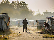 04 MARCH 2017 - KATHMANDU, NEPAL: A man who lives in the camp walks through the IDP camp in the center of Kathmandu. The camp opened days after the April 2015 earthquake devastated Nepal, killing almost 9,000 people. At its peak, about 1,800 families lived in the camp. The camp is still open nearly two years after the earthquake, about 400 families currently live in the camp. Camp residents say the Kathmandu municipal government is trying to close the camp and is encouraging residents to find new housing. They said the government is cutting off services to the camp and last week stopped the free distribution of water, although water can be purchased for delivery. Most of the people in the camp came to Kathmandu from rural villages in the mountains in the weeks after the earthquake. Many of the residents of the camp, technically homeless, have found work in Kathmandu's bustling construction industry, rebuilding homes destroyed in the earthquake.       PHOTO BY JACK KURTZ